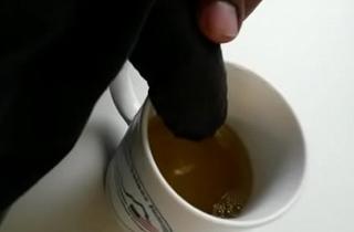 Pee in coffee mug in office