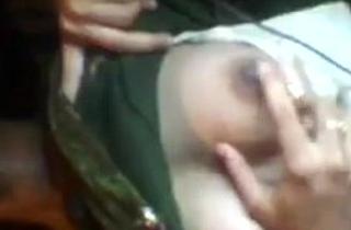 Unsatisfied Rajasthani housewife akin her boobs on skype