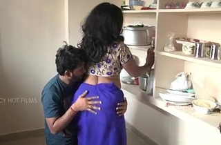 Indian mother and son relationship in kitchen